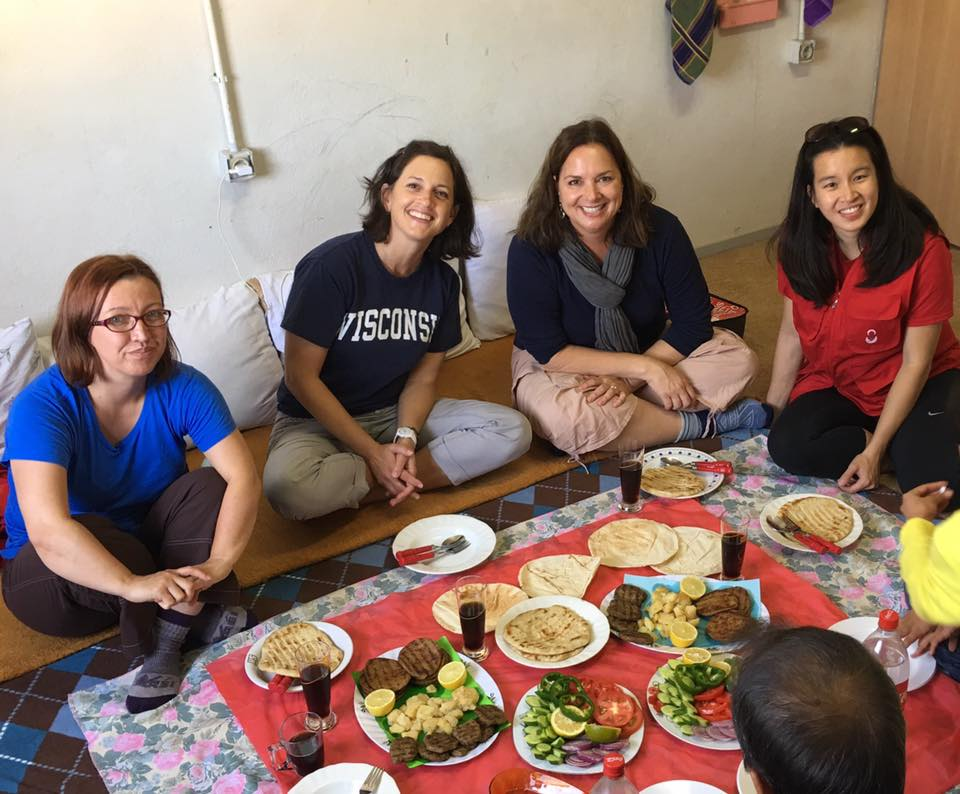 Carry the Future Distribution Team 19 shares a meal with a refugee family